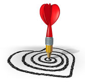 Love Strategy. And creating a target for a vision of the perfect date or marriage by drawing with a pencil shaped as a red dart on a target formed asa valentine Stock Photo
