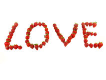 Love of strawberries. Strawberries lined up to spell out the word Love Royalty Free Stock Photography