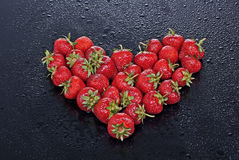 Valentines Day. Strawberries arranged in a heart shape Stock Photography