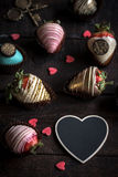 Love and strawberries. Strawberries in the chocolate served with blank chalkboard in heart shape,selective focus stock image