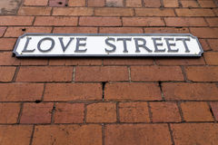 Love Street Sign. On a red brick wall Royalty Free Stock Photos