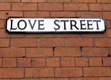 Love Street Sign. On a red brick wall Royalty Free Stock Image