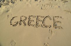 Love summer holidays on the beach sand. Greece Stock Images