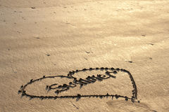 Love of Summer in the Sand. The word summer in the shape of a heart drawn onto a sandy beach Stock Photo