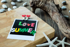 Love Summer word on Blank instant photo Royalty Free Stock Photo