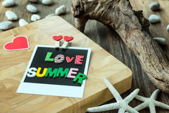 Love Summer word on Blank instant photo Royalty Free Stock Image