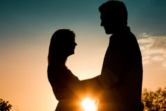 Love - sunset couple embracing each other Royalty Free Stock Image