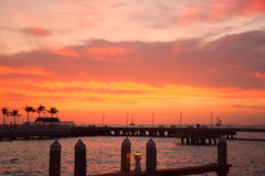 Love at sunset. This photo is taken in key west. The sky is stained red when the sun set. Such a beautiful scenery Royalty Free Stock Photos