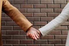 Love support couple teamwork strong relationship. Love and support. Couple teamwork. Protection and togetherness. Strong relationship. Holding hands Stock Photography