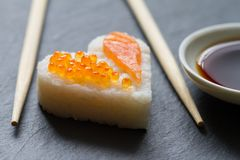 Love sushi abstract menu concept with nigiri heart on black background Stock Images