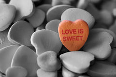 Love is sweet. Valentine candy hearts that say Love is Sweet Royalty Free Stock Images