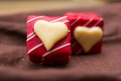 Love sweet heart chocolates Stock Photos