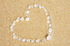 Love symbol. On sand at beach royalty free stock photography