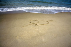 Love Symbol at the beach Royalty Free Stock Images