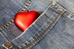 Love symbol in a blue jeans Stock Images
