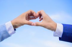 Love symbol concept. Male hands in heart shape gesture symbol of love and romance. Hand heart gesture forms shape using. Fingers. Hands put together in heart stock photos