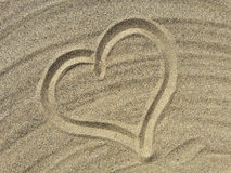 Love symbol draw on the sand Royalty Free Stock Images