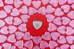 Love symbol. Glitter hearts. Pink hearts on red background. Top view. Valentine`s Day. Symbol of love. Copy space stock photo