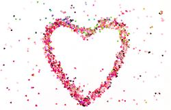Love symbol heart of pink glitter. On white background. top view. copy space royalty free stock photos