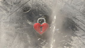 Love symbol hearth in winter ice and water splash Royalty Free Stock Images
