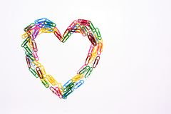 Love symbol. From colorful paper clip isolated on white background royalty free stock photography