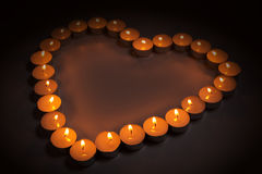 Love symbol made from candles Stock Photos