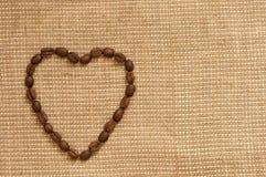 Love symbol made of coffee Stock Photos