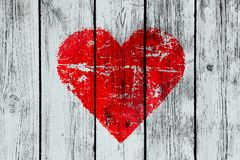 Love symbol on old wooden wall Royalty Free Stock Photography