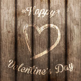 Love symbol on old wooden wall Stock Image