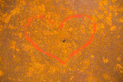 Love symbol painted on background with rust on steel.  royalty free stock photos