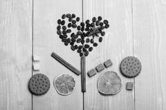 Love symbol presents sweet feeling. Love and food art concept. Pattern made of coffee beans. Cookies, dry orange and cinnamon. Heart shaped flower made of food Royalty Free Stock Photography