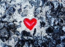 Love symbol red heart in ashes Stock Photography