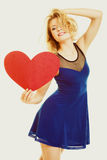 Love symbol. woman holds big red heart Stock Images