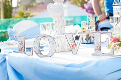 Love Table. Decorative letters on a table Royalty Free Stock Photography