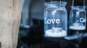 Love tar. Crystal tar with the word love printed over, containing a candle Royalty Free Stock Photography