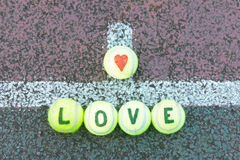 Love tennis - word and heart shape drawn on balls Stock Image