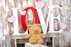 Love text with bear hearts and butterfly Stock Images