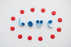 LOVE text from blue paper with red clasper Stock Photos
