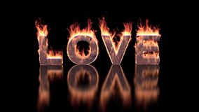 Love text burning in fire on glossy surface stock photos