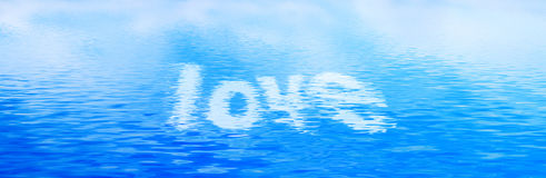 Love text in clean water waves. Banner, panorama. Royalty Free Stock Photos