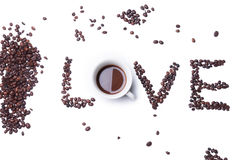 Love text with coffee beans. And mug Royalty Free Stock Photos