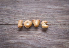 Love text with cookies. Stock Image