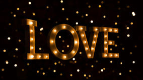 Love text with glowing light bulbs Royalty Free Stock Photography