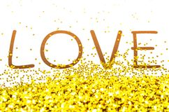 Love text with gold glitter. Stock Photos