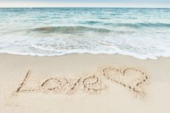 Love Text And Heart Drawn On Sand By Sea Stock Image