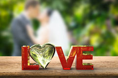 Love text with heart shape Stock Images