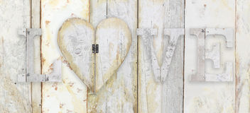 Love text with heart shape on wood planks grunge texture backgro Stock Photo