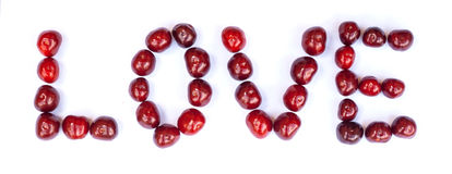 LOVE text made of cherries. Concept. LOVE text made of cherries. Isolated on white background. Isolated on white Royalty Free Stock Photography