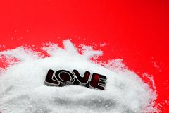 Love text message from cookie form letters on sugar Royalty Free Stock Photo