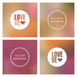 Love Text over abstract colorful blurred background. Royalty Free Stock Images